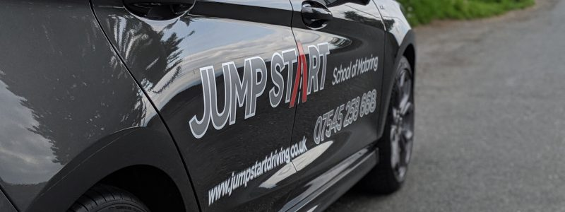 The Jump Start Driving Car with the logo.